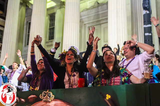 The crowd shouting for the attention of the maskers at the Endymion Parade
